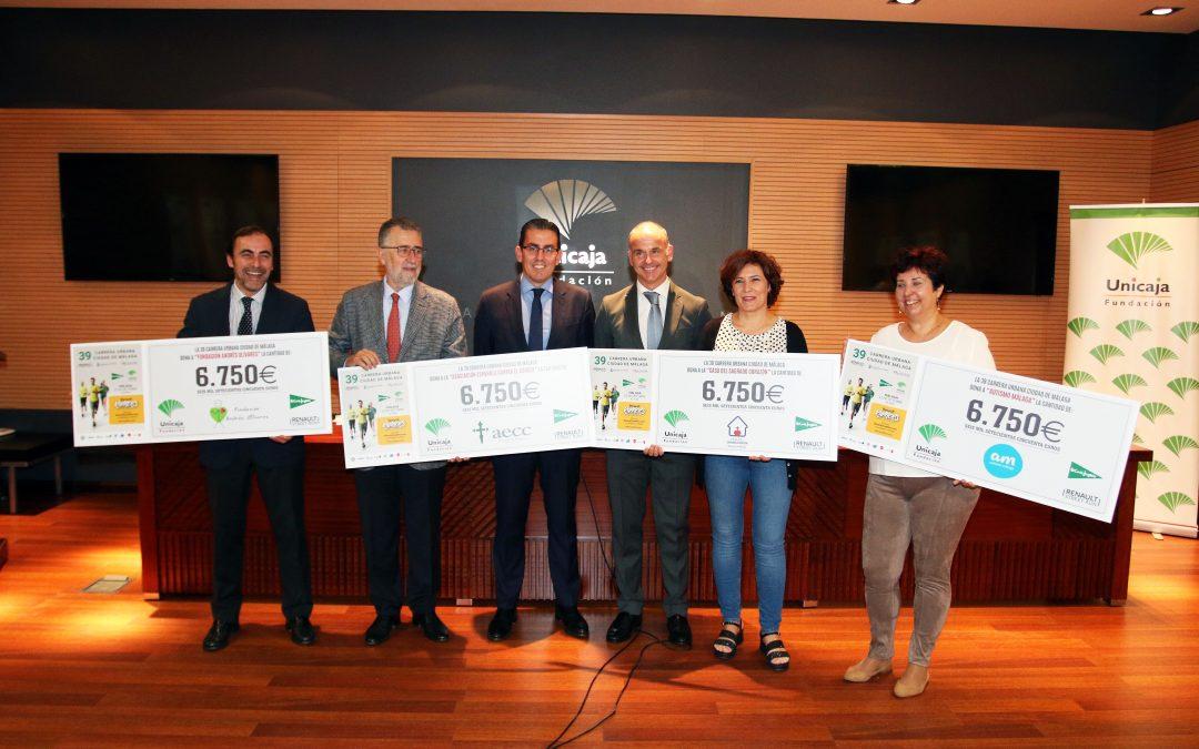 Fundación Unicaja entrega los 27.000 euros recaudados en la Carrera Ciudad de Málaga