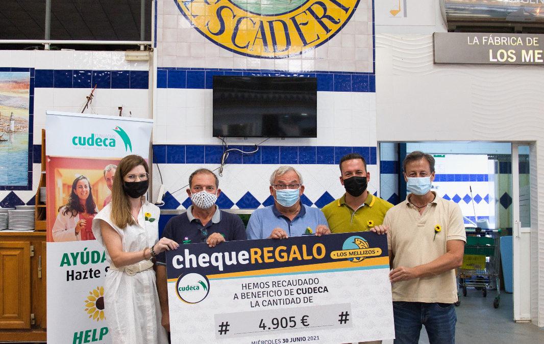Los Mellizos entregan los fondos recaudados para Cudeca por su plato solidario